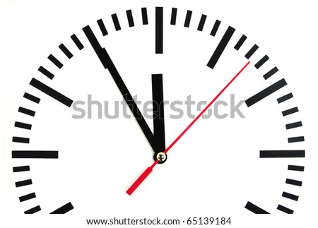 Large clock shows five minutes to twelve - stock photo