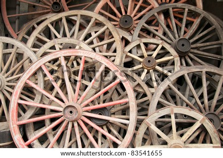 Large collection of antique rustic farm wagon wheels. #83541655