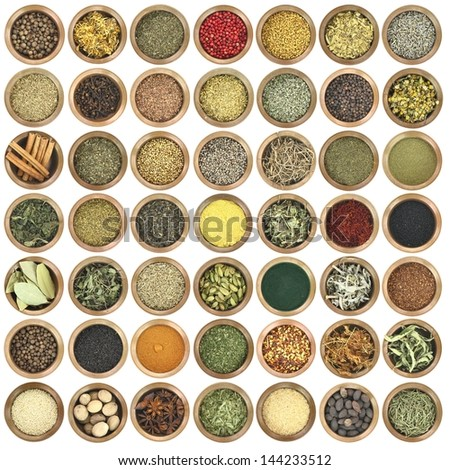 Large collection of metal bowls full of herbs and spices