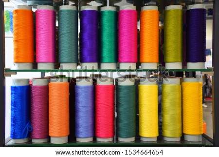 Large colorful polypropylene threads set in rainbow mood. Multicolored bobbin thread. Polypropylene multifilament yarns. Set of sewing thread coils, miscellaneous colours. #1534664654