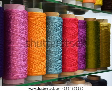Large colorful polypropylene threads set in rainbow mood. Multicolored bobbin thread. Polypropylene multifilament yarns. Set of sewing thread coils, miscellaneous colours. #1534671962
