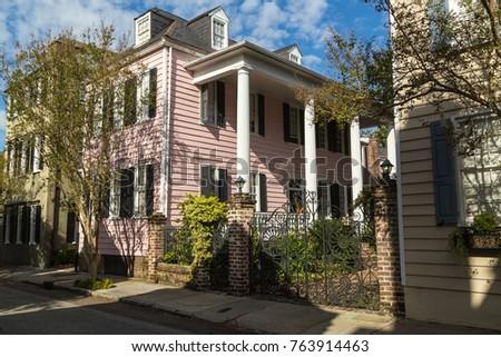 Large columns on Historic mansion in historic Charleston South Carolina Harbor Area. #763914463