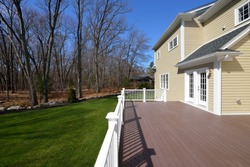 Large composite deck on colonial style house.