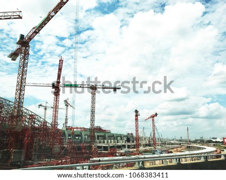 Large construction site including several cranes working on a building complex, #1068383411