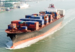 Large container ship arriving in port.