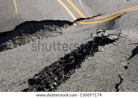 Large cracks in the road, the destruction of the roadway