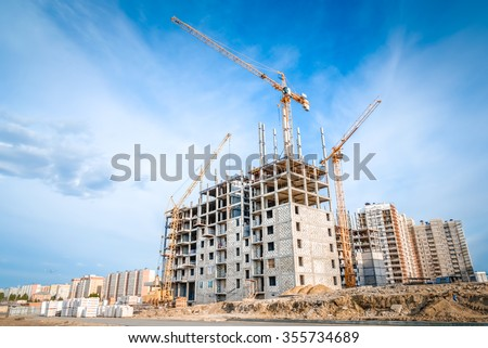 Large crane and construction of building Stockfoto ©