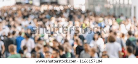 large crowd of defocused people #1166157184