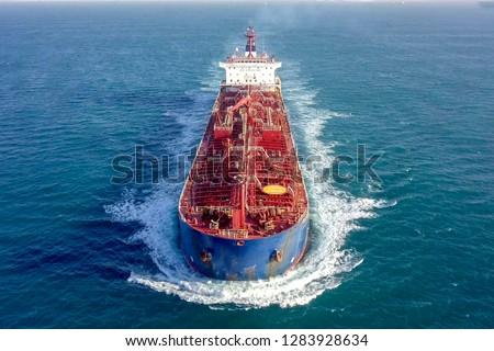 Large crude oil tanker roaring across The Mediterranean sea - Aerial image.