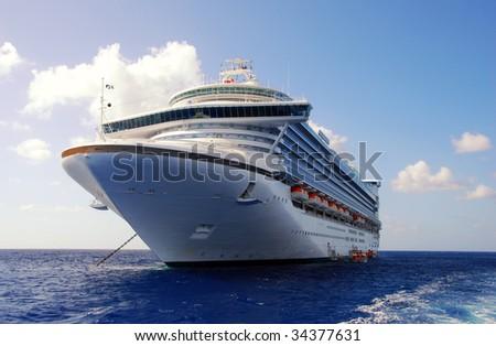 Large cruise ship anchored near island