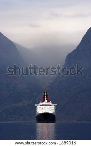 Large cruise ship entering a Norwegian fjord - front view