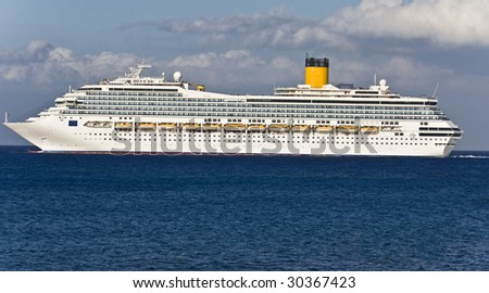 Large cruiser sailing outside Rhodes island in Greece at summer time