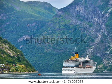 Large cruiseship in narrow Geiranger fiord, Norway