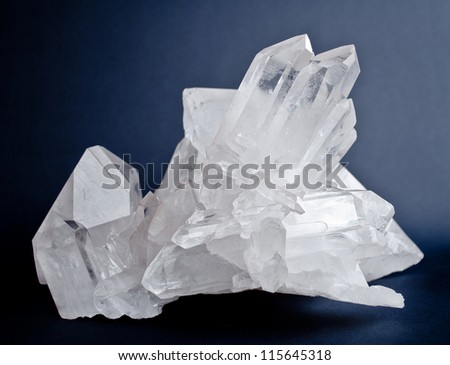 Large crystals of white quartz on dark blue background