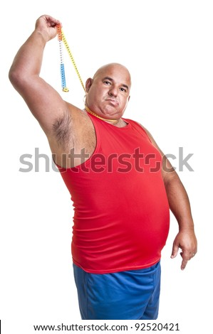 Large desperate man hanging himself with a measuring tape isolated in white