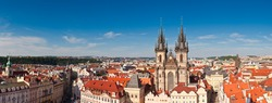 Large detailed panoramic of the Old Town Square in Prague, visible are Kinsky Palace and the fairytale gothic towers of the Church of Our Lady Tyn (1365).