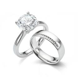 Large Diamond Ring with Diamond Wedding Ring Jewellery Set on White Background