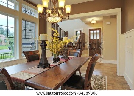 Large Dining Room With Wood Floors And Area Rug Stock