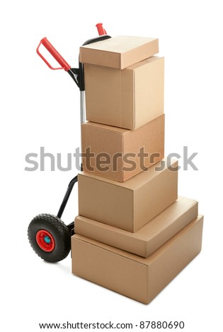 Large dolly with brown shipping boxes isolated on white background - stock photo