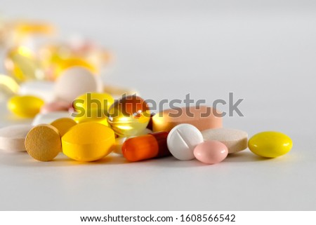 Large dosage of medicines. These varied tablets have various shapes and various colors.