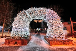 Large elk antler arches curve over Jackson Hole, Wyoming's square's four corner entrances. The antlers have been there since the early 1960s, and new arches are currently assembled to replace them.
