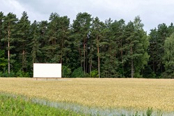 large empty billboard for outdoor advertising on the highway, empty billboard in nature by the roadside