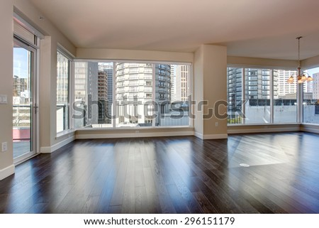 Large empty living room with fireplace and hardwood floor. #296151179