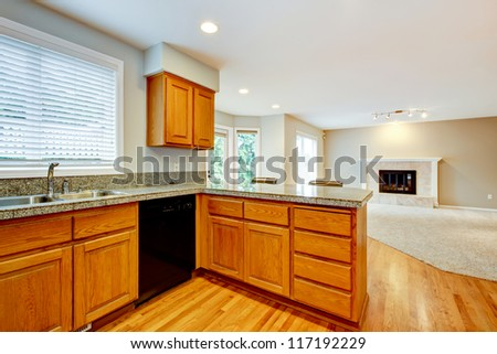 Large empty open new kitchen with living room house interior.