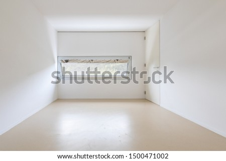 Large empty room with window looking nature and Swiss hills. Nobody inside