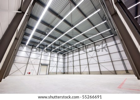 large, empty warehouse interior made from prefab parts