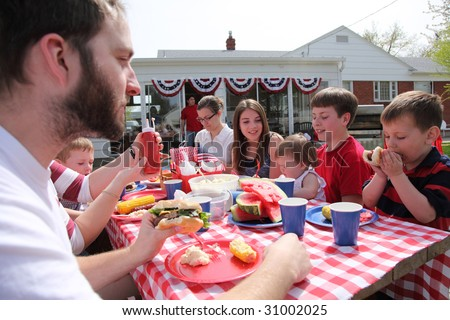 Large family gathering for a 4th of July barbecue