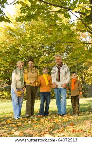large family plays in the autumn park - stock photo