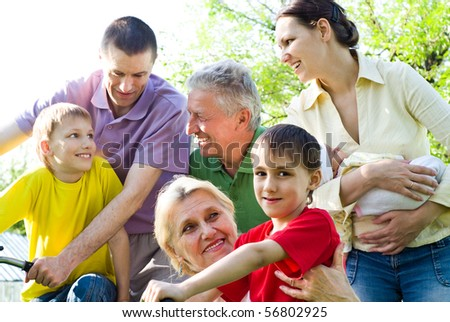 large family plays in the park