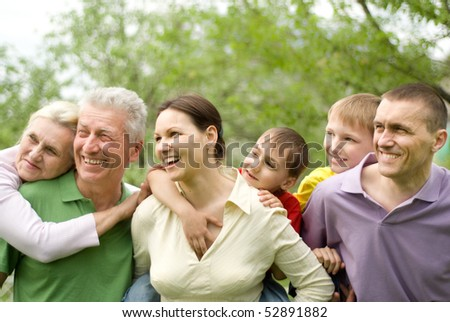 large family plays in the summer park