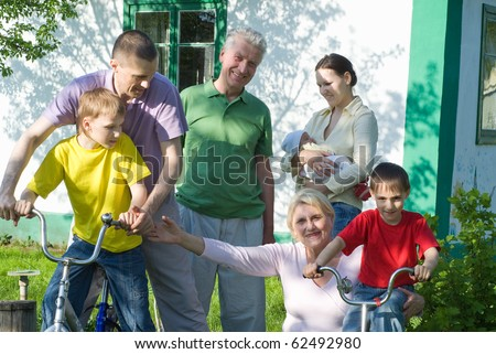 large family plays in the summer park - stock photo
