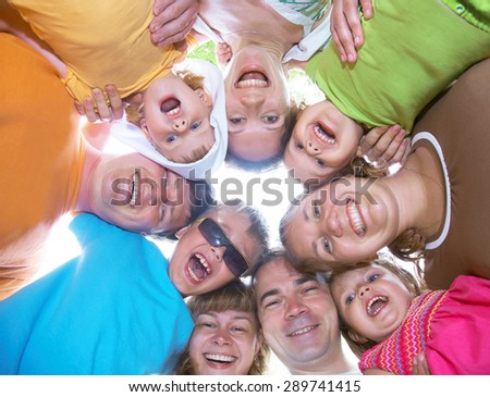 large family with children having fun together in the nature