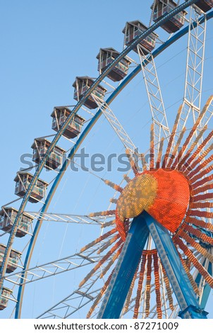 Large Ferris Wheel with Gondolas and Electric Lights