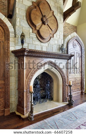 Large fireplace in family room with stone chimney