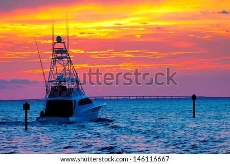 Large fishing boat going out for a sunset cruise in Destin, Florida