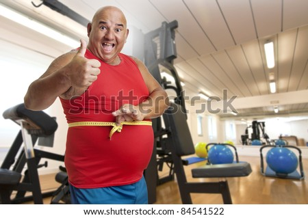 Large fitness man with measuring tape