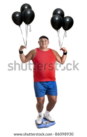 Large fitness man with weight scale and balloons isolated in white