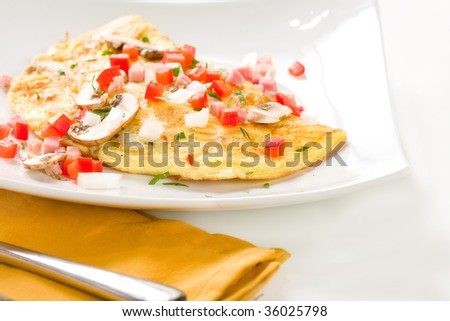 Large Folded omelette with ham, peppers, onion and mushroom