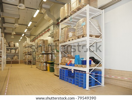 Large food warehouse with steel shelves, copy space