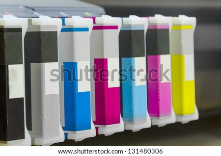 large format ink jet printer cartridge with paper roll closeup