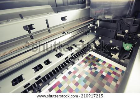 large format ink jet printer printing color management target on paper roll, VINTAGE