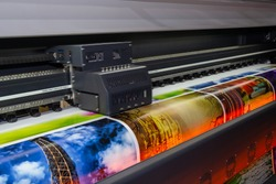 Large format printing machine in operation. Industry