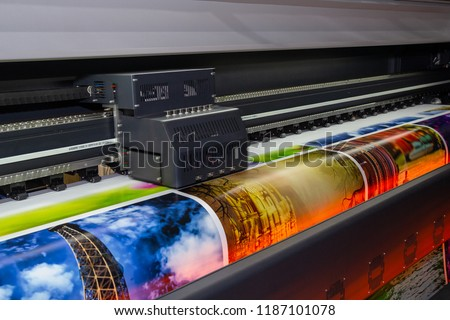 Photo of  Large format printing machine in operation. Industry