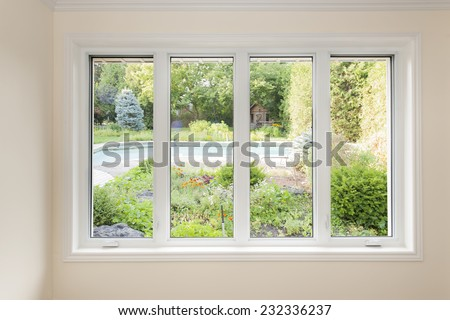 Large four pane window looking on summer backyard with pool and garden #232336237