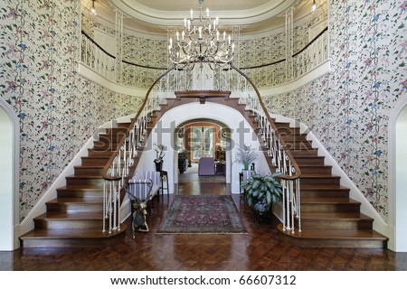 Large foyer in luxury home with double staircase - stock photo