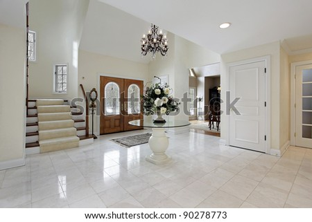 Large foyer with stained glass door windows